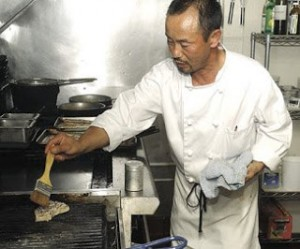 Chef Soo Song prepares a dish at main street bar and grill in Suisun city.